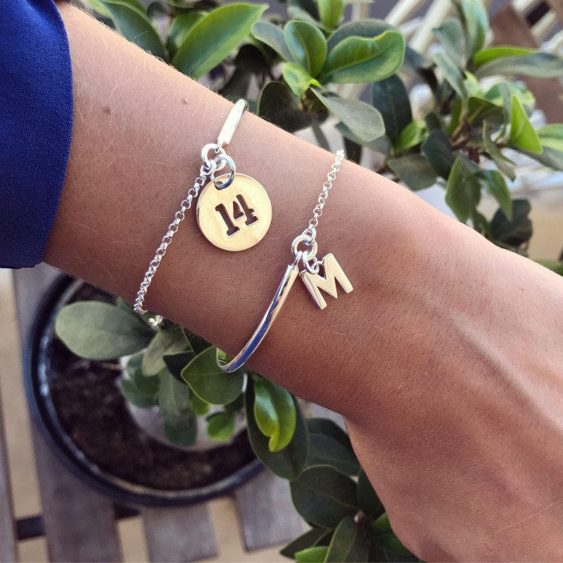 Half bangle and chain bracelet with a lettter charm