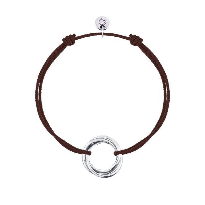 Tie bracelet with three silver rings