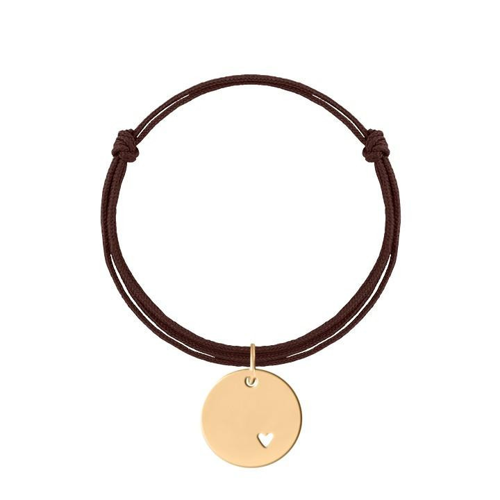 Tie bracelet with perforated heart medal