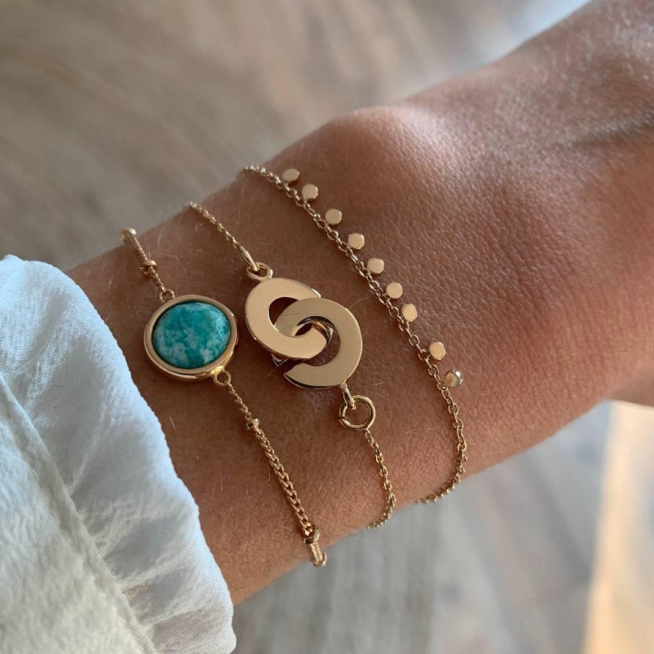 Gold-plated chain bracelet with small handcuffs