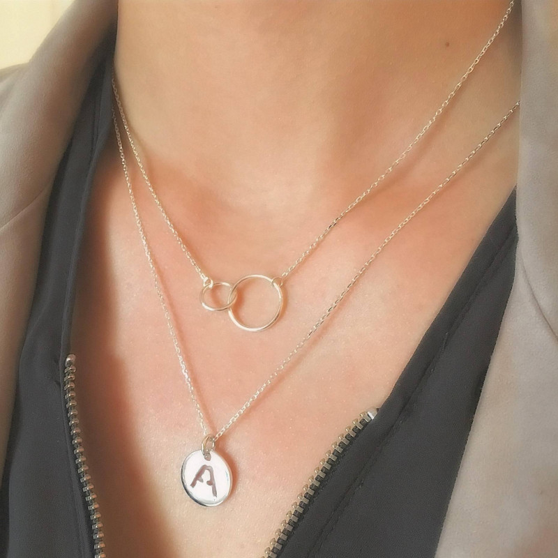 Silver chain necklace with perforated initial letter