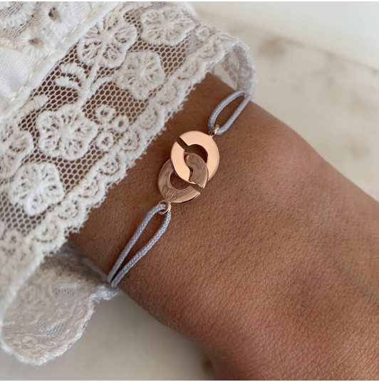 Tie bracelet with small handcuffs