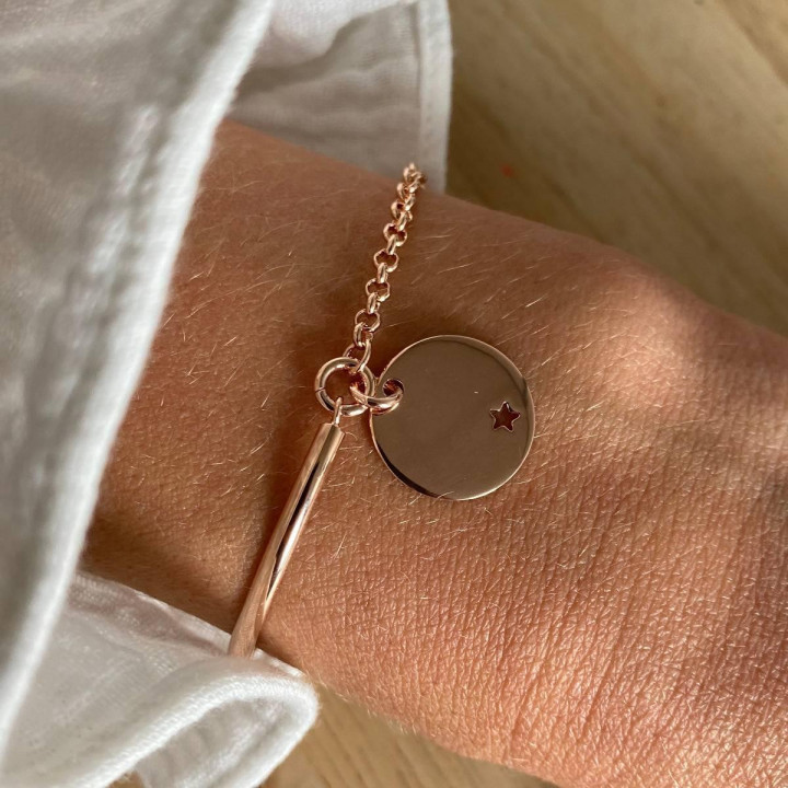 Rose gold-plated half bangle and chain bracelet with small perforated star medal