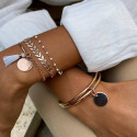 Rose gold-plated bangle bracelet with medal