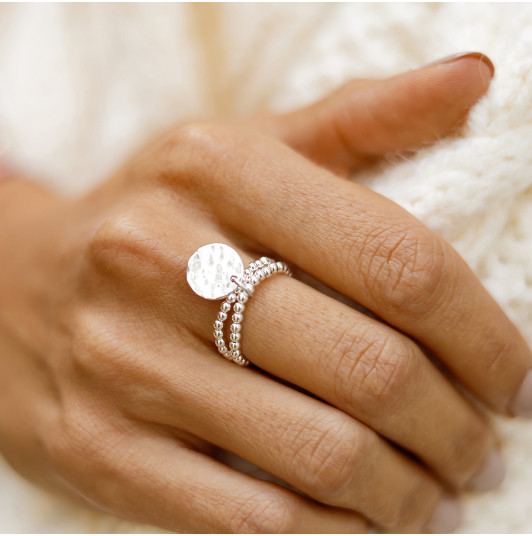 Two-row beaded ring with small hammered medal