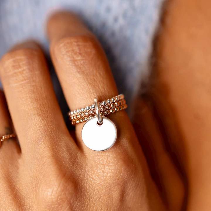 Combination of three ring and a medal