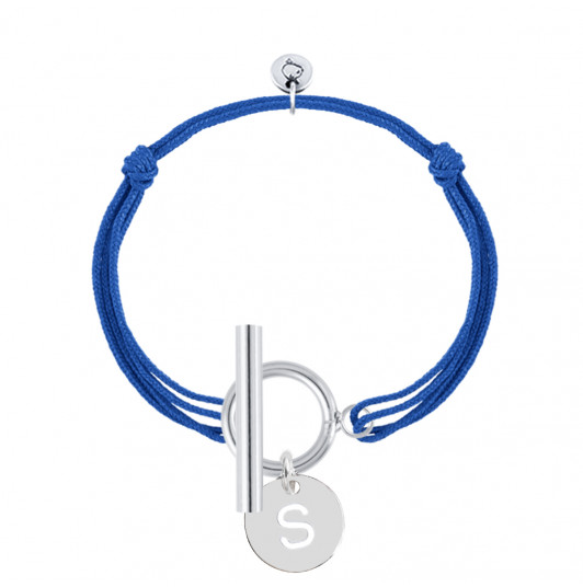 Tie bracelet with T-toggle & hollowed initial medal