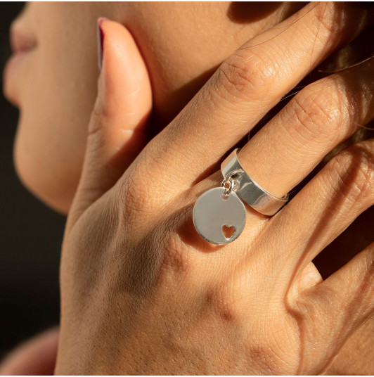 Band ring with small hollowed heart medal