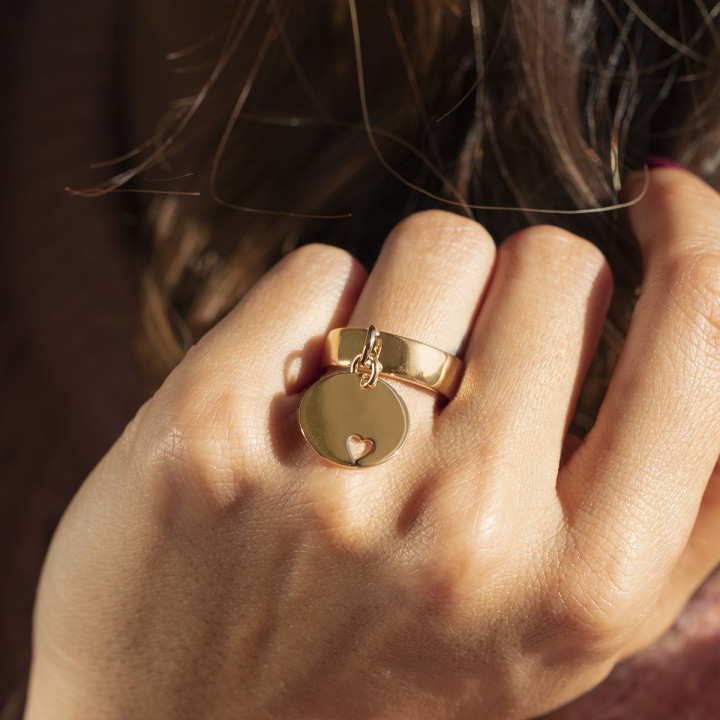Gold-plated band ring with small hollowed heart medal