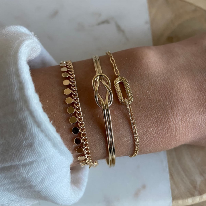 Gold-plated chain bracelet with small hanging medals