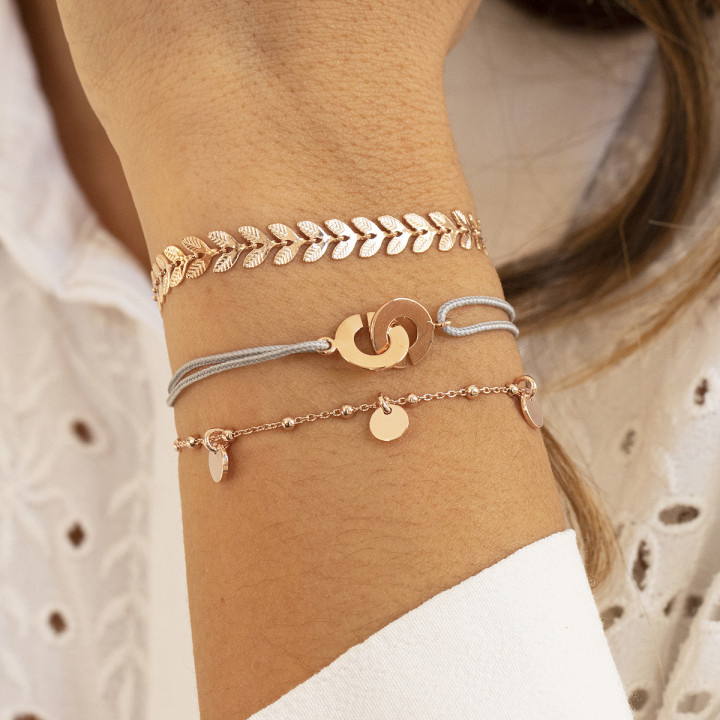 Tie bracelet with rose gold-plated small handcuffs