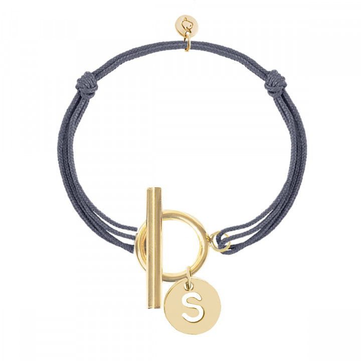 Gold-plated tie bracelet with T-toggle & hollowed initial medal