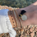 Gold-plated open bangle bracelet with ethnic engravings
