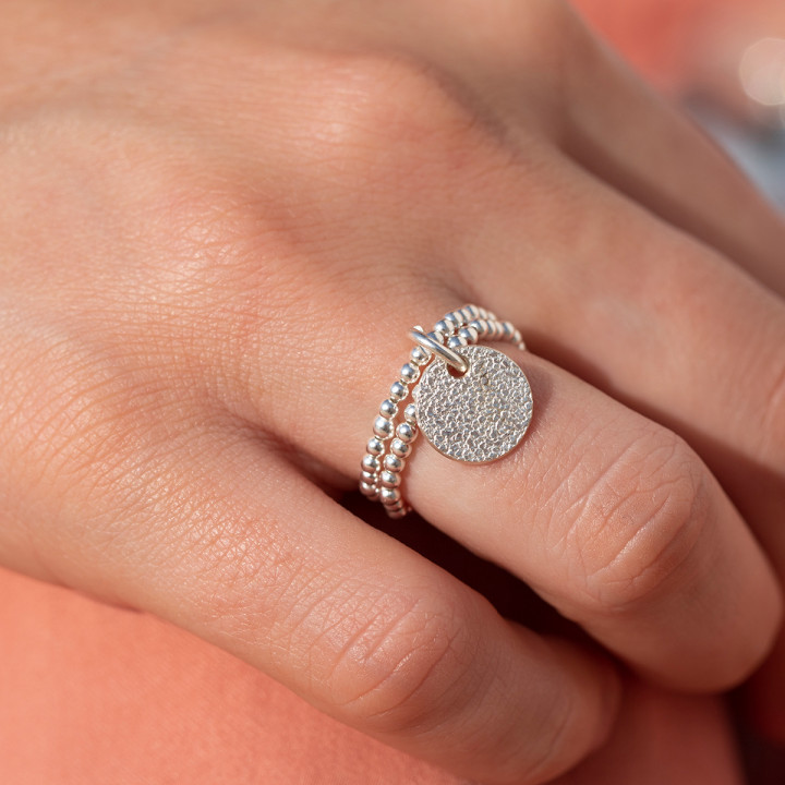 925 Silver two-row beaded ring with small granite medal