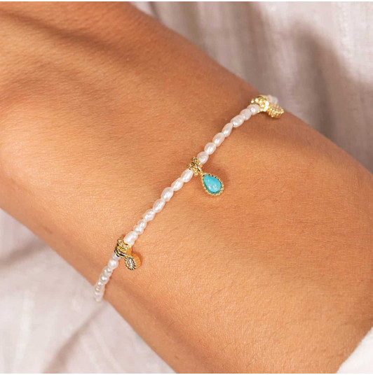 Silky thread bracelet with nacre beads & Turquoise medal