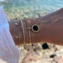 Gold-plated half bangle and chain bracelet with beaded Onyx medal