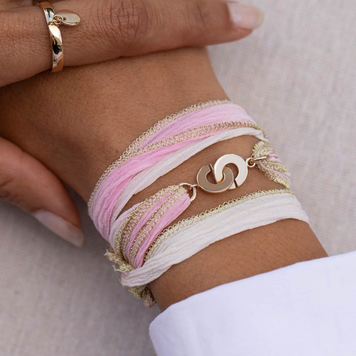 Gold-plated silk ribbon bracelet with small handcuffs