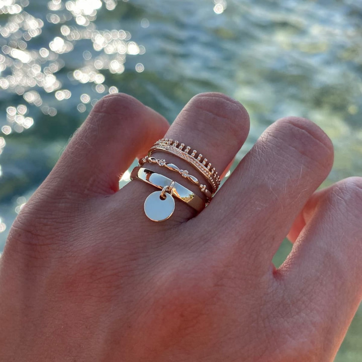 Gold-plated band ring with small medal