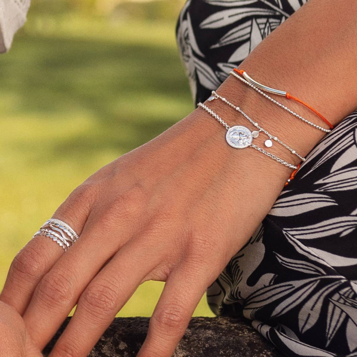 Tie bangle bracelet with perforated initial medal