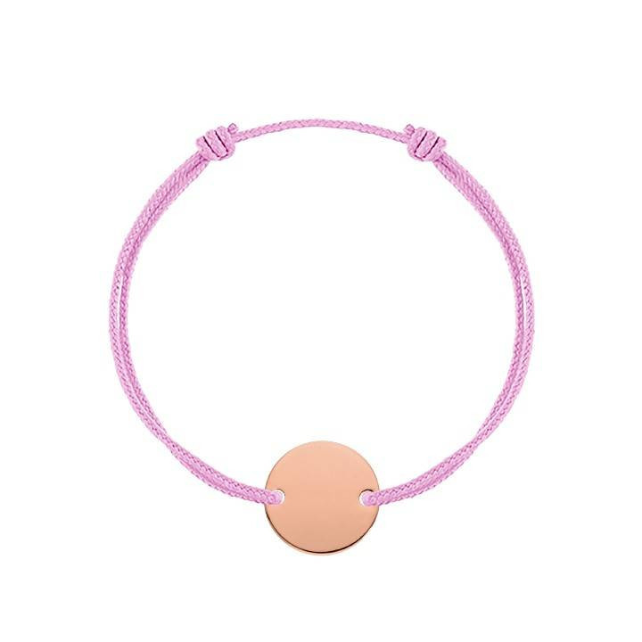 Tie bracelet with large perforated heart medal