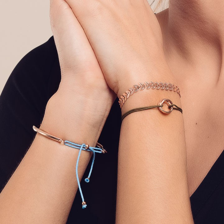 Tie bracelet with small perforated heart medal