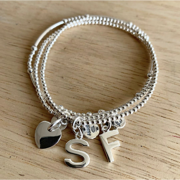 Beads bracelet with a letter charm