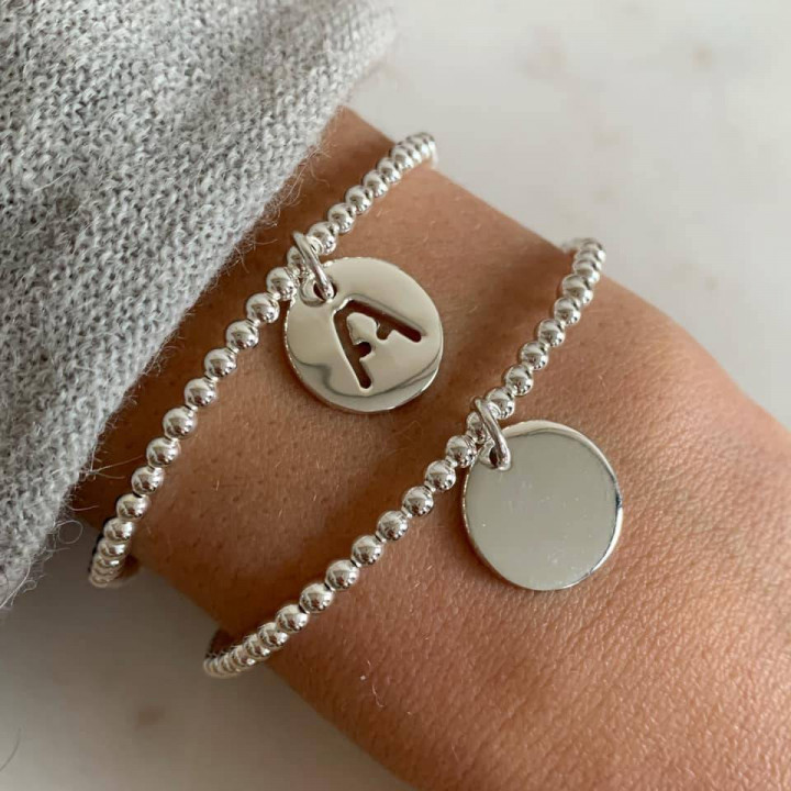 3 mm beads and perforated initial medal bracelet