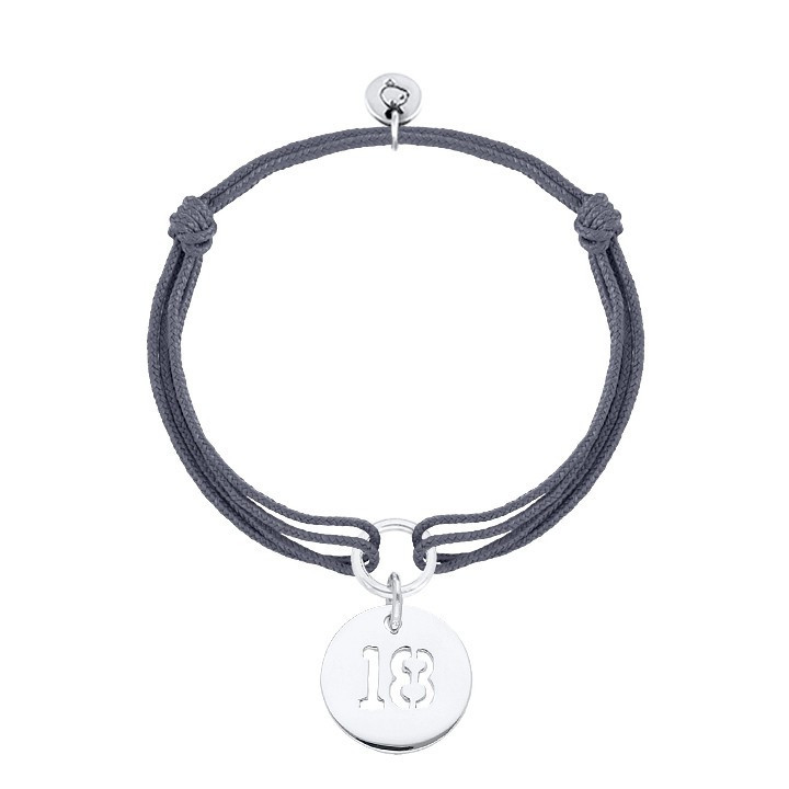 Tie bracelet with perforated number medal