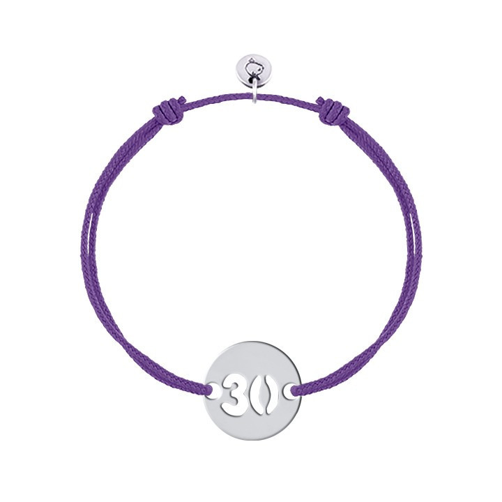 Tie bracelet with perforated initial number
