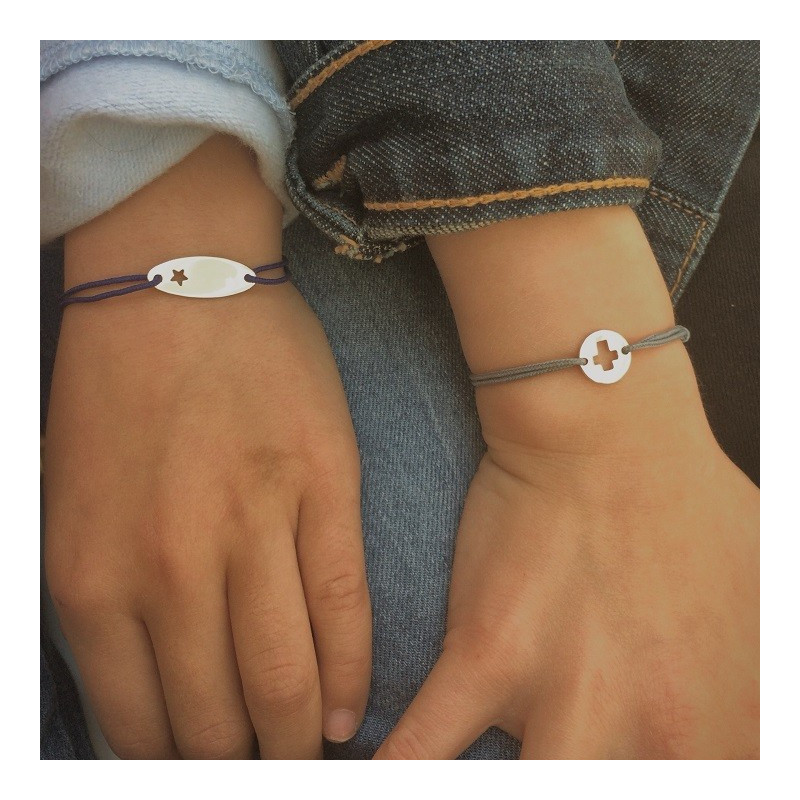 Tie bracelet with perforated cross for children