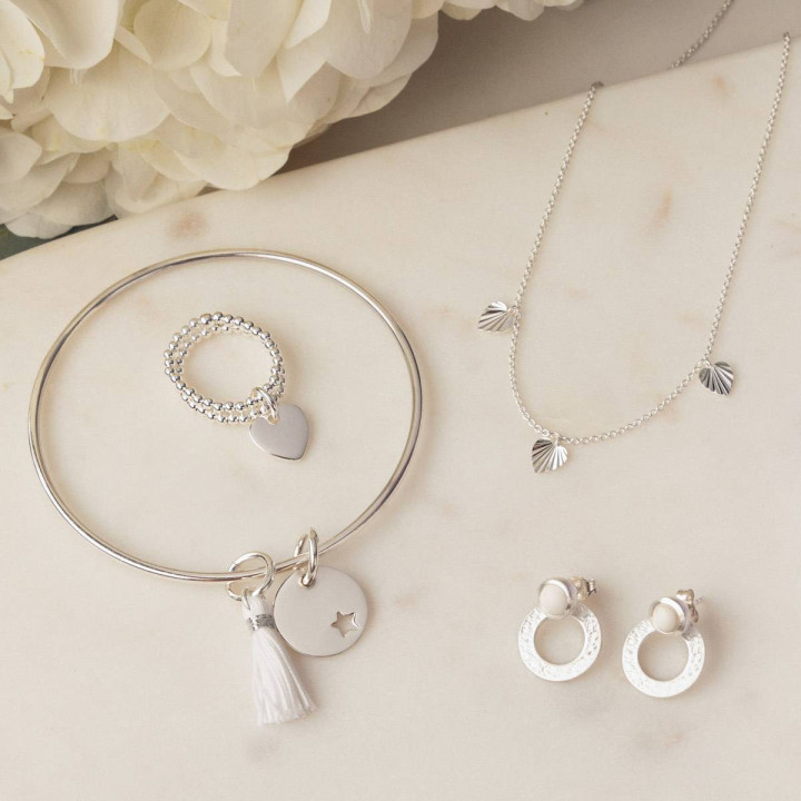 925 silver thin bangle bracelet with perforated star medal and pompom