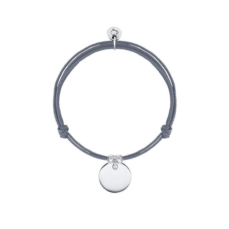 Tie bracelet with charm and beads