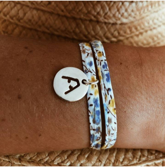 Liberty bracelet with perforated initial medal