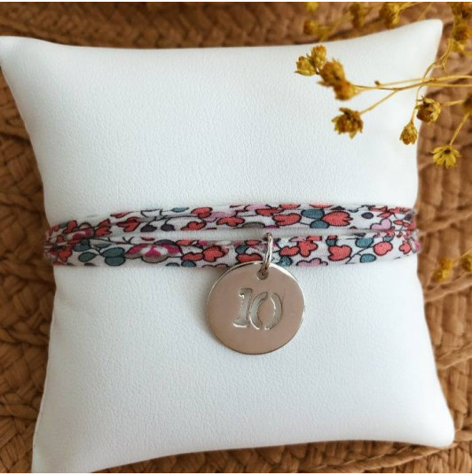 Liberty bracelet with perforated number medal for children