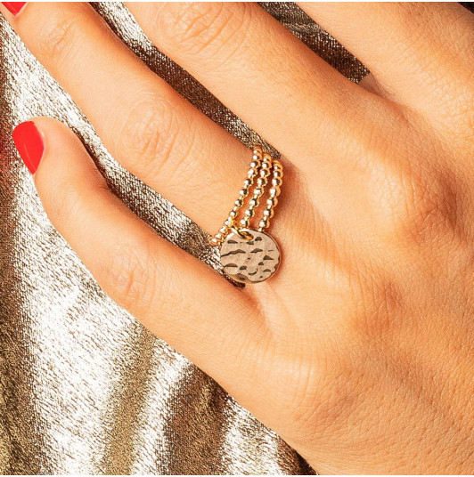 Combination of thin rings & hammered medal