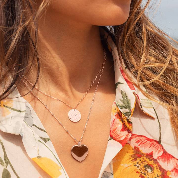 Rose gold-plated beaded chain necklace with curved heart medal