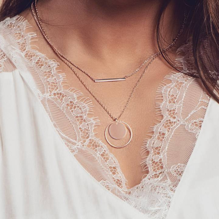 Rose gold-plated chain necklace with ring and medal