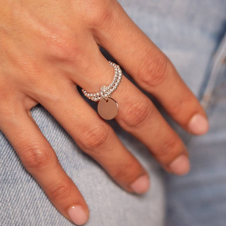 Small rounded rose gold-plated medal on double beaded ring