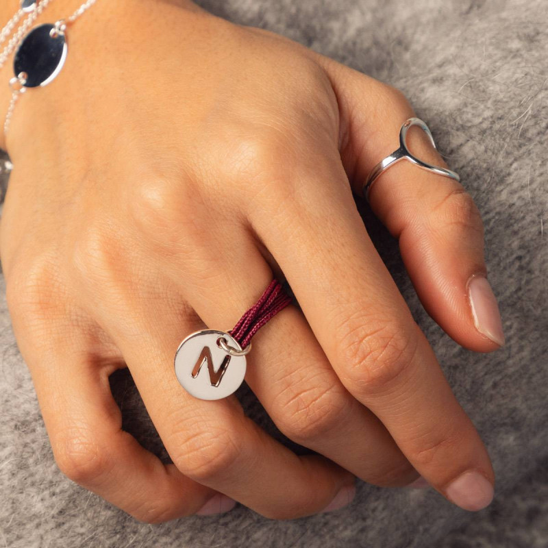 Multiple string ring with inital letter