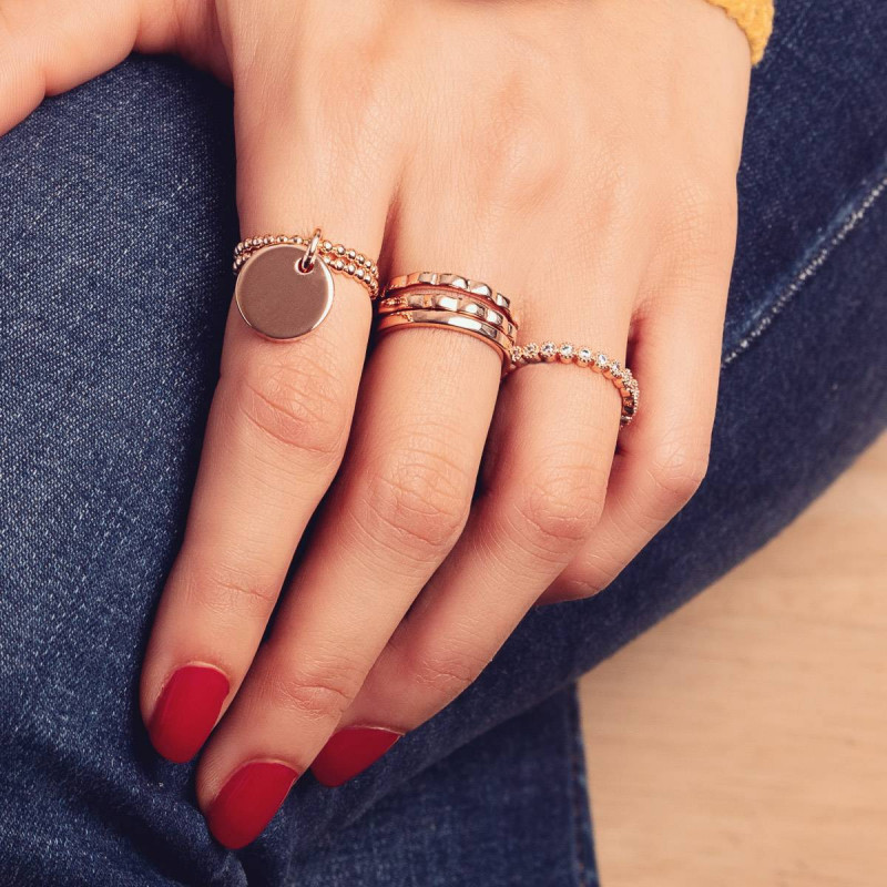 Wavy and many zirons ring